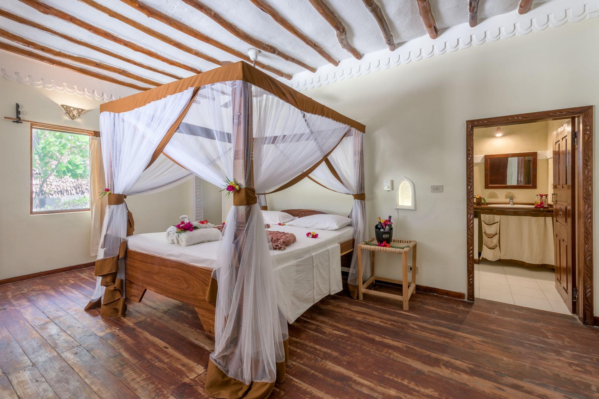 Hakuna Majiwe Beach banda room with mosquito net